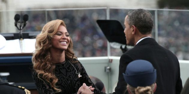 WASHINGTON, DC - JANUARY 21: U.S. President Barack Obama greets singer Beyonce after she performs the...