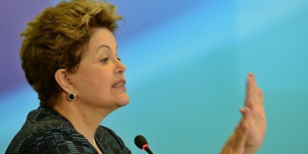 Brazilian President Dilma Rousseff delivers a speech during the announcement of the authorization to...