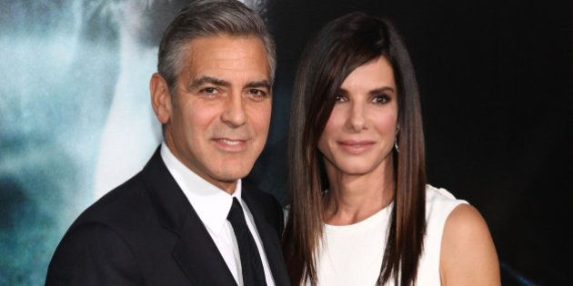 NEW YORK, NY - OCTOBER 01: Actors George Clooney and Sandra Bullock attend the 'Gravity' premiere at...