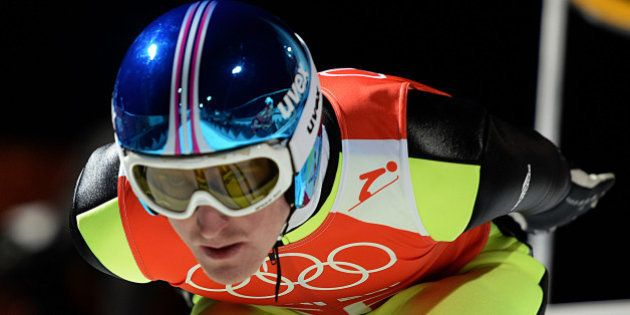 Germany's Severin Freund gets ready before the Men's Ski Jumping Large Hill Official training jump at...