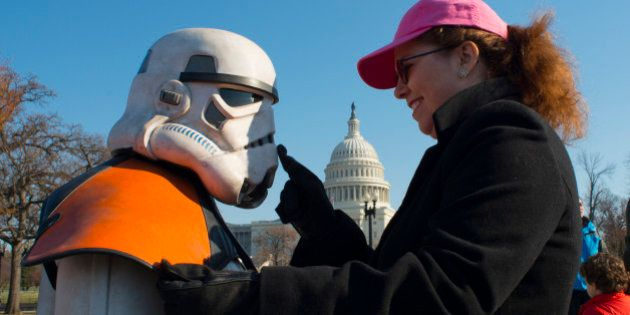 WASHINGTON, DC - DECEMBER 1: Dieter Jobe, dress as a stormtrooper gets attention from his wife Shannon...