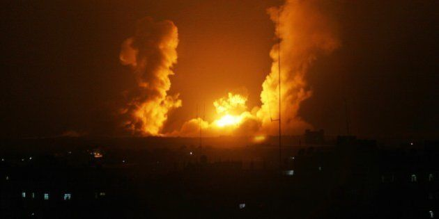 A ball of fire is seen following an Israel airstrike in Rafah, southern Gaza, on July 1, 2014. Israeli...