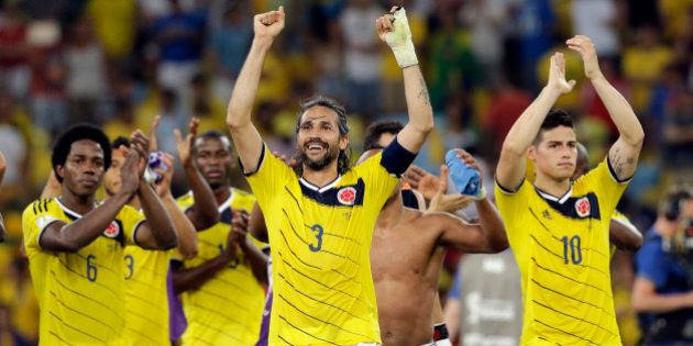 Colombia's James Rodriguez, right, Mario Yepes, center, and Carlos Sanchez Moreno, left, celebrate after...