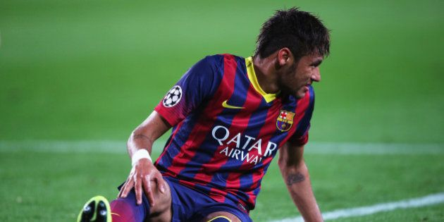 BARCELONA, SPAIN - APRIL 01: Neymar of Barcelona grimaces as he goes to ground during the UEFA Champions...