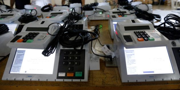 Electoral technicians finalize preparation of electronic voting machines to be used in the upcoming general...