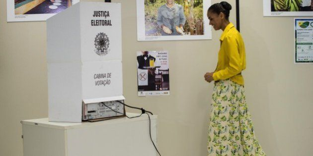 Brazilian Marina Silva(C) presidential candidate for the Brazilian Socialist Party (PSB) is going to...