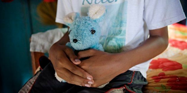 SIHANOUKVILLE, CAMBODIA - 2010/07/24: The 'adopted' son of a 63 year-old Swedish man convicted of pedophilia,...