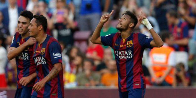 Barcelona's Neymar from Brazil celebrates after scoring during a Spanish La Liga soccer match between...