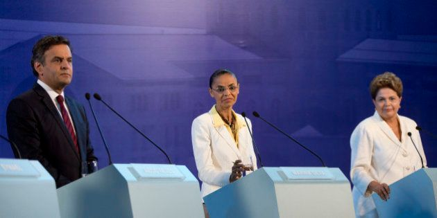 Aecio Neves, presidential candidate of the Brazilian Social Democracy Party, PSDB, left, Marina Silva,...