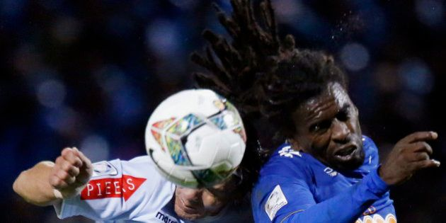 Garcilaso player Ramon Rodriguez vies fro the ball against Tinga of Cruzeiro during their first round...
