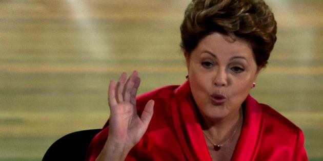 Brazilian President Dilma Rousseff gestures during celebrations to mark the 34th anniversary of the founding...