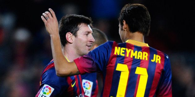 BARCELONA, SPAIN - FEBRUARY 15: Lionel Messi of FC Barcelona celebrates with his teammate Neymar after...
