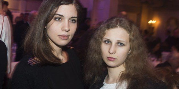 Nadezhda Tolokonnikova (L) and Maria Alyokhina (R) of Russian punk protest group Pussy Riot arrive for...