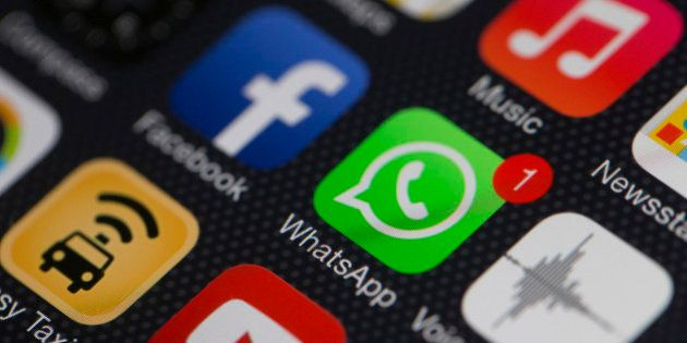 The WhatsApp Inc. mobile-messaging application WhatsApp and the Facebook Inc. application are displayed...