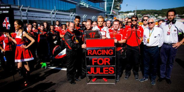 SOCHI, RUSSIA - OCTOBER 12: Max Chilton of Great Britain and his team of Marussia along with the FIA...