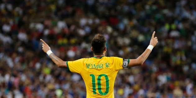 Brazil's Neymar celebrates after scoring the forth goal during an international friendly soccer match...