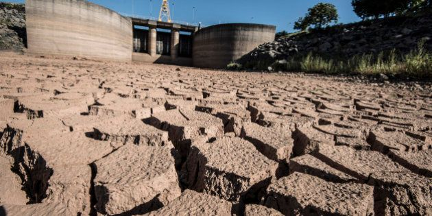 Dry, cracked earth is seen where water usually stands at the Jaguari Dam, managed by Cia. de Saneamento...
