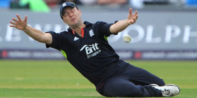 England's Jonathan Trott fails to catch Pakistan's Umar Gul during their first One Day International...