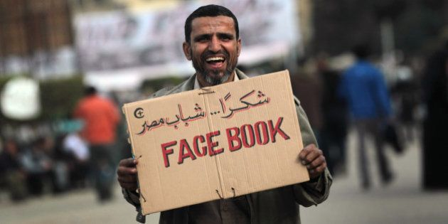 CAIRO, EGYPT - FEBRUARY 03: An anti-government demonstrator holds a sign during clashes on February 3,...