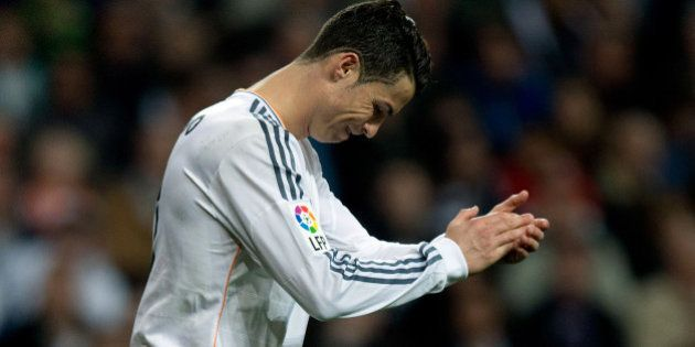 MADRID, SPAIN - MARCH 09: Cristiano Ronaldo of Real Madrid CF claps congratulating his team during the...