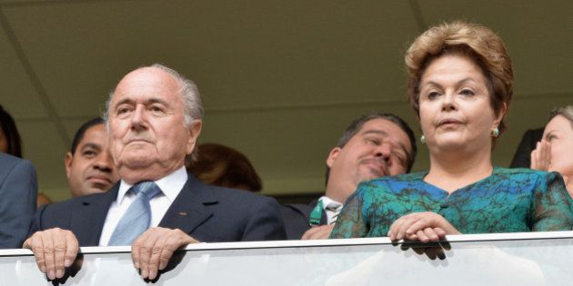 BRASILIA, BRAZIL - JUNE 15: FIFA President Sepp Blatter (l) looks on with the President of Brazil Dilma...