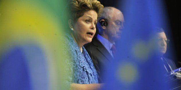 EU Council president Herman Van Rompuy (C), European Commission President Jose Manuel Barroso (R) and...