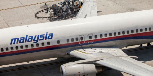 A Boeing Co. 737 aircraft operated by Malaysian Airline System Bhd. (MAS) is refueled on the tarmac at...