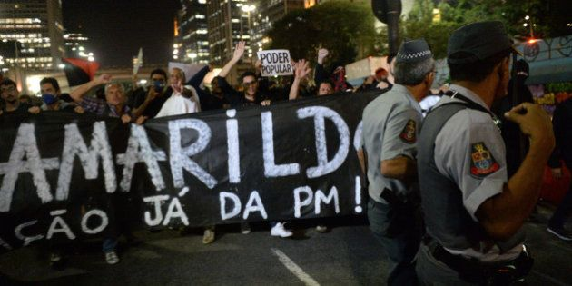 People demonstrate against the disappearance of 42-year-old construction worker Amarildo de Souza who...
