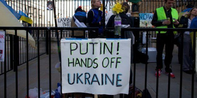 Anti-Russian activists stand outside Downing Street during a pro-Ukraine protest in London on March 15,...
