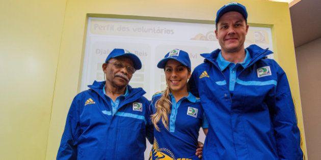 RIO DE JANEIRO, BRAZIL - MAY 16: (L-R) Djalma dos Reis, Luiza Waddington and Guy Salvi volunteers of...