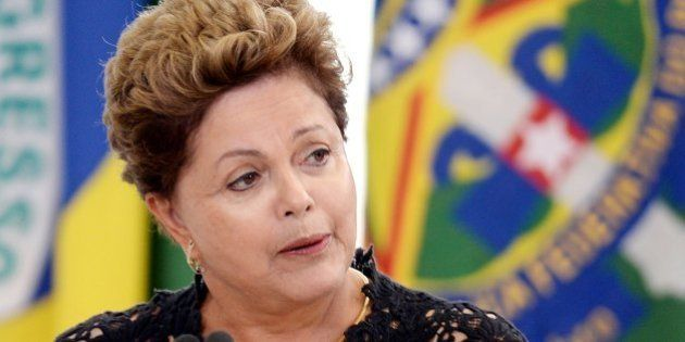 Brazilian President Dilma Rousseff delivers a speech during the taking on ceremony of new ministers --to...