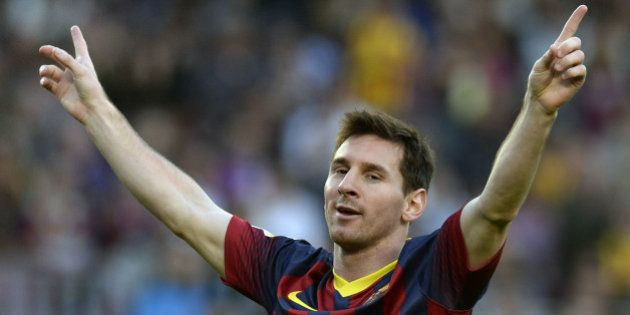 Barcelona's Argentinian forward Lionel Messi celebrates after scoring a goal during the Spanish league...