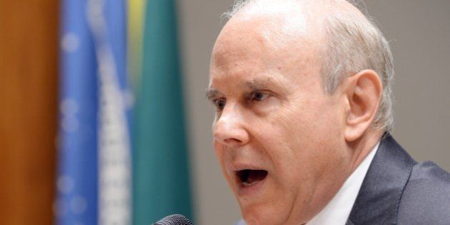 Brazilian Finance Minister Guido Mantega speaks during a press conference in Brasilia on January 3, 2014....