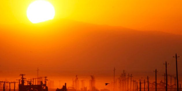 LOST HILLS, CA - MARCH 24: The sun rises over an oil field over the Monterey Shale formation where gas...
