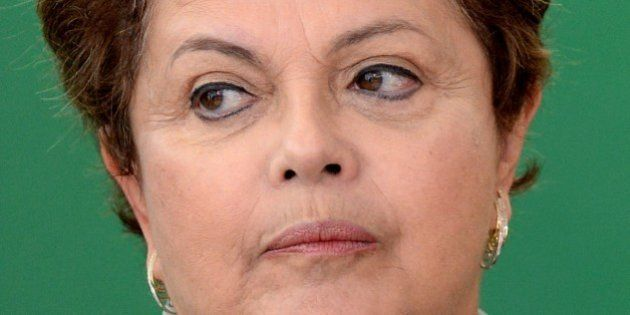 Brazilian President Dilma Rousseff looks on during the swearing-in ceremony of new ministers, at Planalto...
