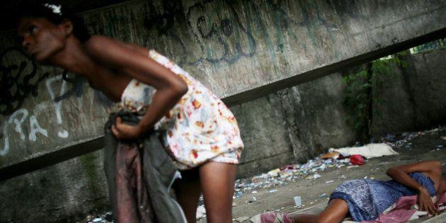 RIO DE JANEIRO, BRAZIL - DECEMBER 10: Drug users gather beneath an overpass in an area known as 'Cracolandia',...