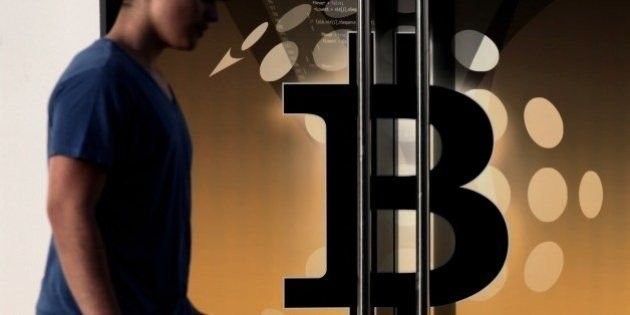 A man walks past the bitcoin firm Neo&Bee offices on April 3, 2014 in the Cypriot capital Nicosia. The...