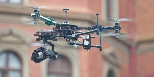 PRETORIA, SOUTH AFRICA - MARCH 19 (SOUTH AFRICA OUT): A journalist operates a drone outside the Pretoria...