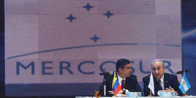 Venezuela's Interior and Justice Minister Miguel Rodríguez Torres (L) speaks with Argentinan security...