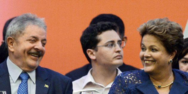 Former Brazilian President Luiz Inacio Lula da Silva (L) and Brazilian President Dilma Rousseff take...