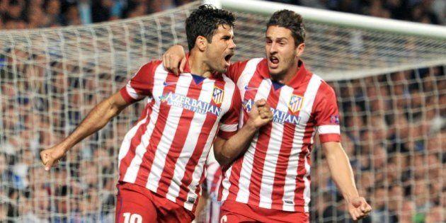 Atletico Madrid's Brazilian-born forward Diego da Silva Costa (L) celebrates scoring his team's second...