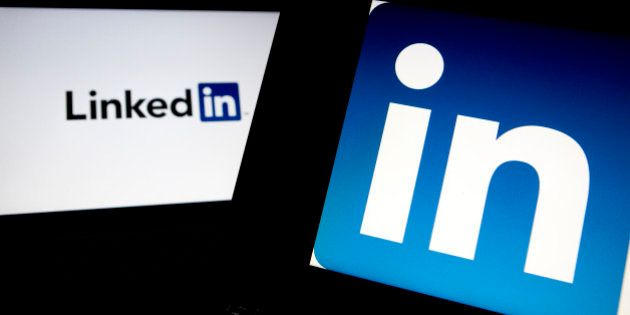 LinkedIn Corp. logos are displayed on laptop computers arranged for a photograph in Washington, D.C.,...