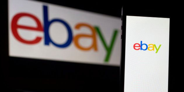 The eBay Inc. logo is displayed on a laptop computer and Apple Inc. iPhone 5s in this arranged photograph...