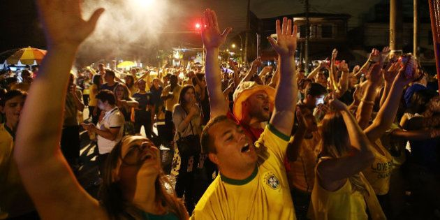SAO PAULO, BRAZIL - JUNE 12: Fans celebrate in Vila Madalena after Brazil won their opening match over...