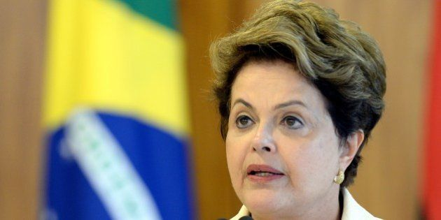 Brazilian President Dilma Rousseff delivers a speech during a signing-of-agreements ceremony with Angola's...