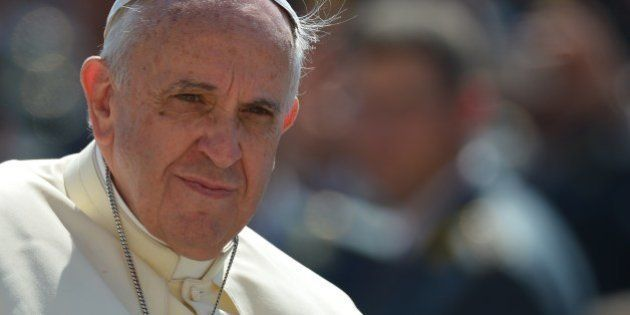 Pope Francis arrives for his general audience at St Peter's square on June 11, 2014 at the Vatican. AFP...