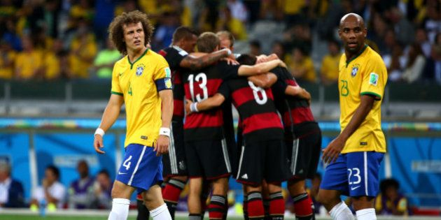 BELO HORIZONTE, BRAZIL - JULY 08: David Luiz and Maicon of Brazil look dejected after allowing Germany's...
