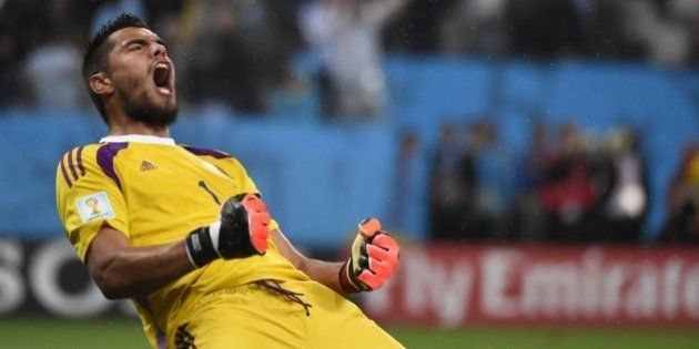 Argentina's goalkeeper Sergio Romero reacts after saving a penalty by Netherlands' midfielder Wesley...