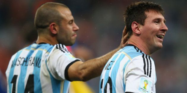 SAO PAULO, BRAZIL - JULY 09: Javier Mascherano and Lionel Messi of Argentina celebrate victory over the...