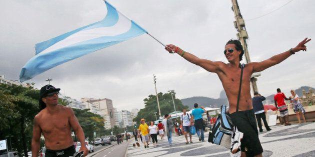 RIO DE JANEIRO, BRAZIL - JULY 11: Argentine fans celebrate on Copacabana Beach ahead of their 2014 FIFA...